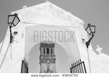 Andalusian Traditional Facade And Arch With Lamps. Spain