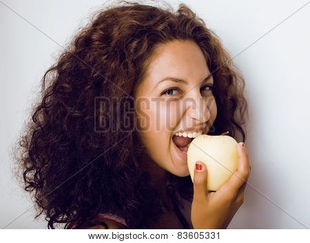pretty young girl eating apple close up