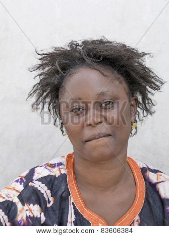 THIAROYE, SENEGAL, AFRICA - JULY 18, 2014 - Unidentified woman sitting in the street
