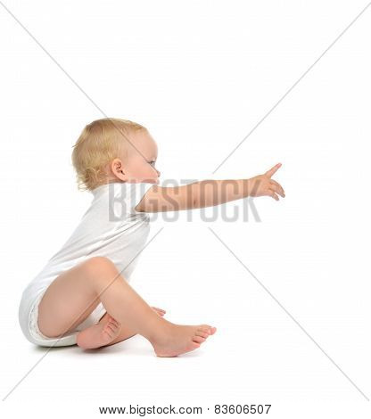 Infant Child Baby Toddler Sitting With Hand Pointing Finger Straight