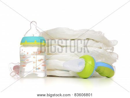 New Born Child Stack Of Diapers Nipple Soother Baby Feeding Milk Bottle