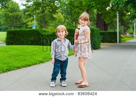 Outdoor portrait of two adorable kids on a nice warm evening