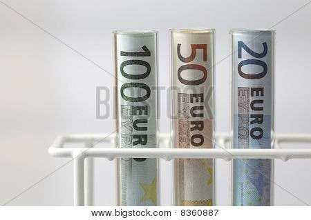 Euro Banknotes In Test Tubes