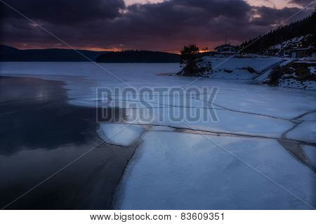 Frozen Lake In The Snowy Mountain