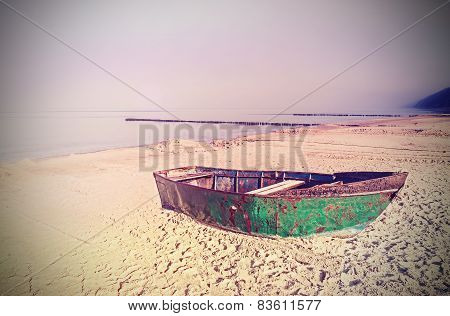 Retro Old Film Effect On Rusty Steel Boat On The Beach.