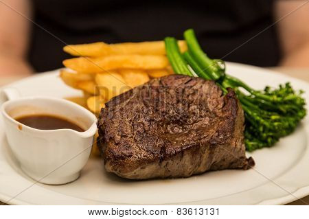 Steak With Broccoli And Fries