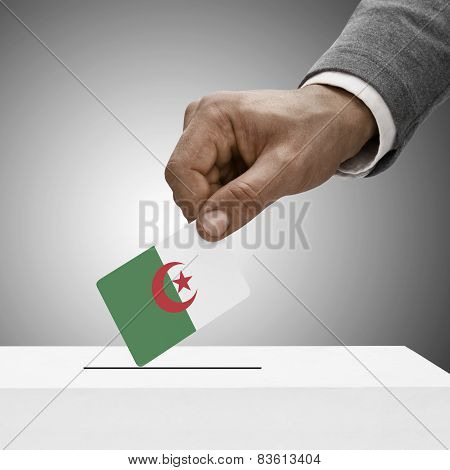 Black Male Holding Flag. Voting Concept - Algeria