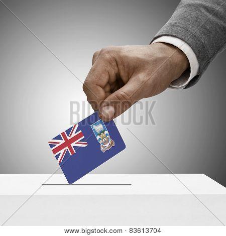 Black Male Holding Flag. Voting Concept - Falkland Islands
