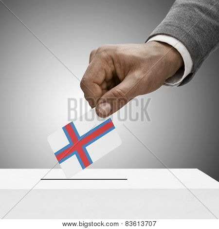 Black Male Holding Flag. Voting Concept - Faroe Islands