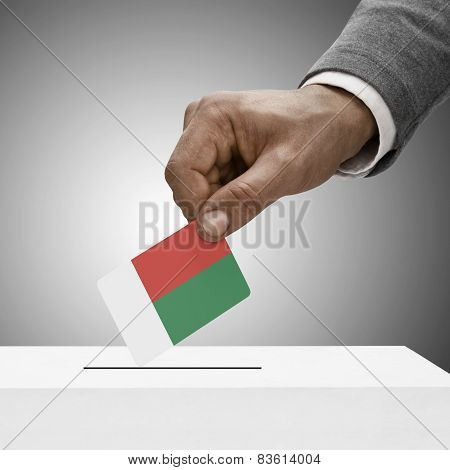 Black Male Holding Flag. Voting Concept - Madagascar