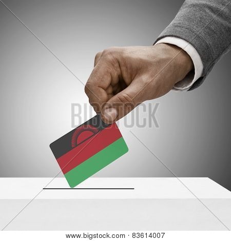 Black Male Holding Flag. Voting Concept - Malawi