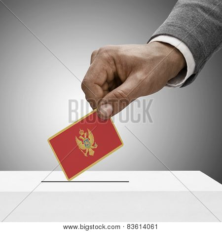 Black Male Holding Flag. Voting Concept - Montenegro