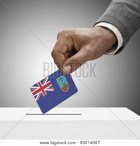 Black Male Holding Flag. Voting Concept - Montserrat