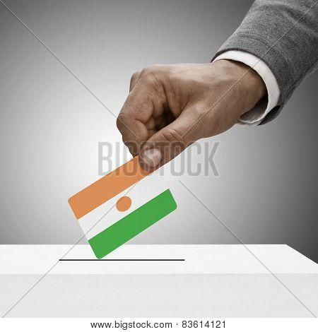 Black Male Holding Flag. Voting Concept - Niger