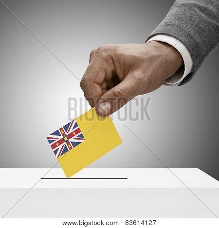 Black Male Holding Flag. Voting Concept - Niue