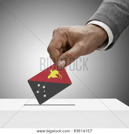 Black Male Holding Flag. Voting Concept - Papua New Guinea