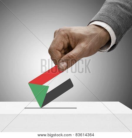 Black Male Holding Flag. Voting Concept - Sudan