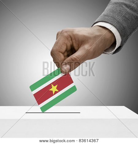 Black Male Holding Flag. Voting Concept - Surinam