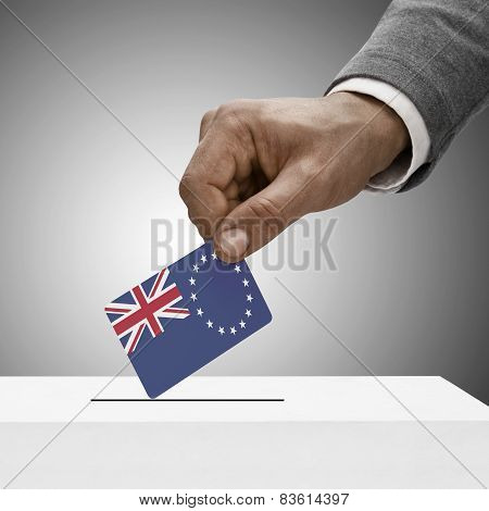 Black Male Holding Flag. Voting Concept - Cook Islands