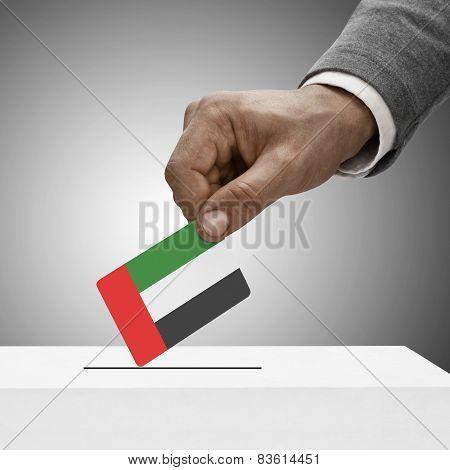 Black Male Holding Flag. Voting Concept - United Arab Emirates