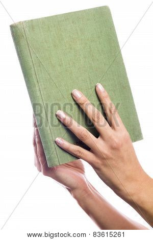 Hands Holding An Old Book