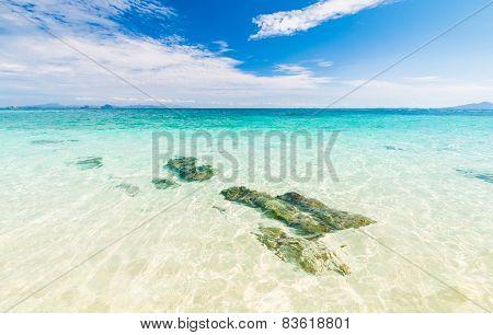 Rocks In Beautiful Turquoise Crystal Clear Sea Water