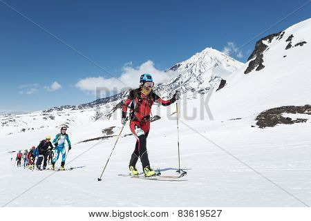 Ski Mountaineering Championships: Group Ski Mountaineer Climb On Skis On Background Volcano