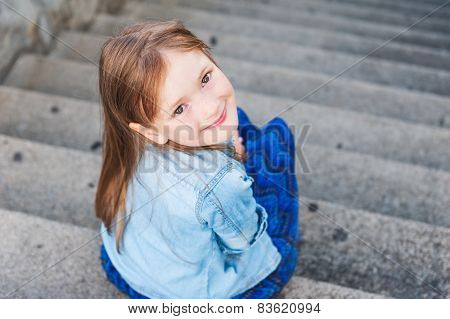 Portrait of a cute little girl, foreshortening portrait, face up