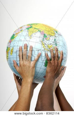 Hands holding up a globe