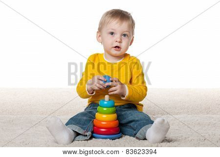 Clever Infant Boy With A Toy