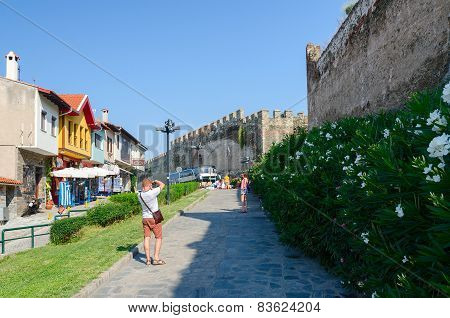 Greece, Thessaloniki, Tourists Are Photographed On A Narrow Street Near The Fortress Walls