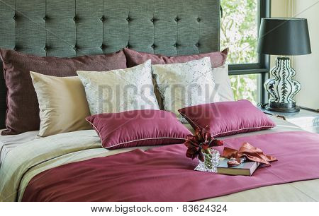 Colorful Pillow And Decorative Tray With Book, Flower On The Bed