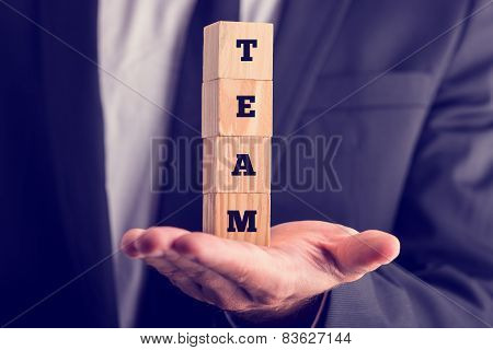 Business Man Holding Wooden Cubes Reading - Team