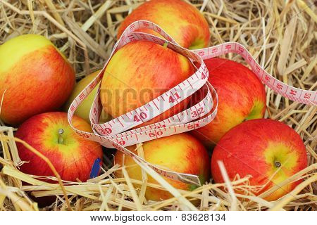 Measure Tape And Red Apple
