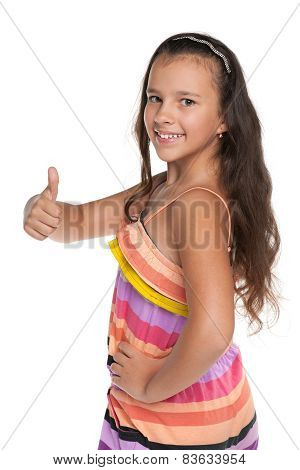 Smiling Preteen Girl Holds Her Thumb Up