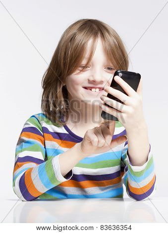 Boy Reading Text Message On Mobile Phone