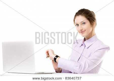 Young Woman Checking Time In Front Of Laptop