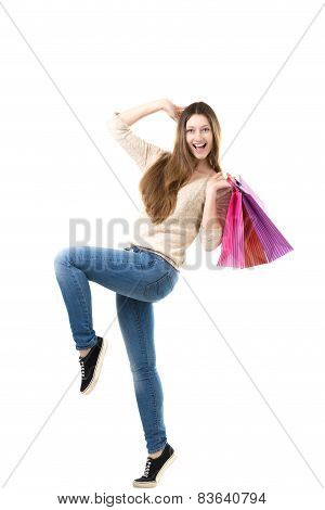 Beautiful Teenage Girl Joyfully Dancing With Pink Shopping Bags In Her Hands