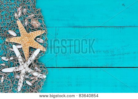 Starfish and shells in fish netting on teal blue wood sign
