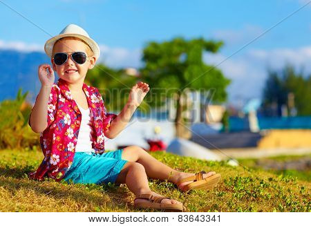 Happy Fashionable Kid On Summer Meadow