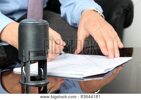 Businessman Working With Documents In The Office . Closeup View Of  Seal