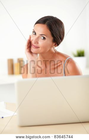 Sophisticated Woman Working On Her Laptop