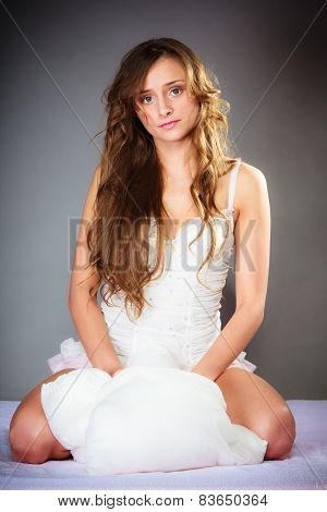 Attractive Woman With Pillow.