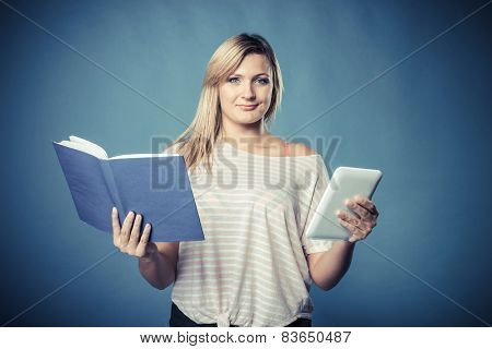 Woman With Traditional Book And E-book Reader Tablet