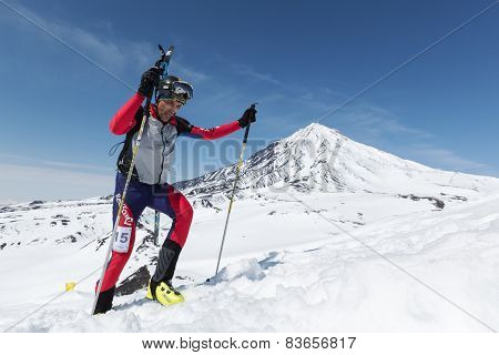 Ski Mountaineering: Ski Mountaineer Climb To Mountain With Skis Strapped To Backpack