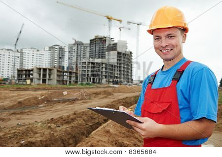 Smiling Builder Inspector At Construction Area