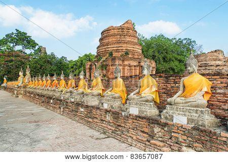 Aligned Buddha Statues With Orange Bands In Ayutthaya, Thailand
