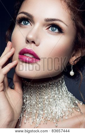 Beautiful brunette model with brown hair. Gems. Bride with fashion wedding hairstyle.