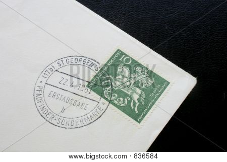 Postage stamp and envelope