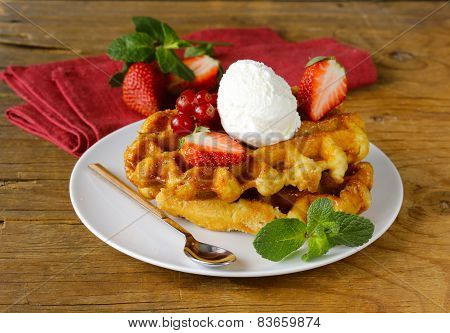 Belgian waffles with berries (currants, strawberries) and ice cream
